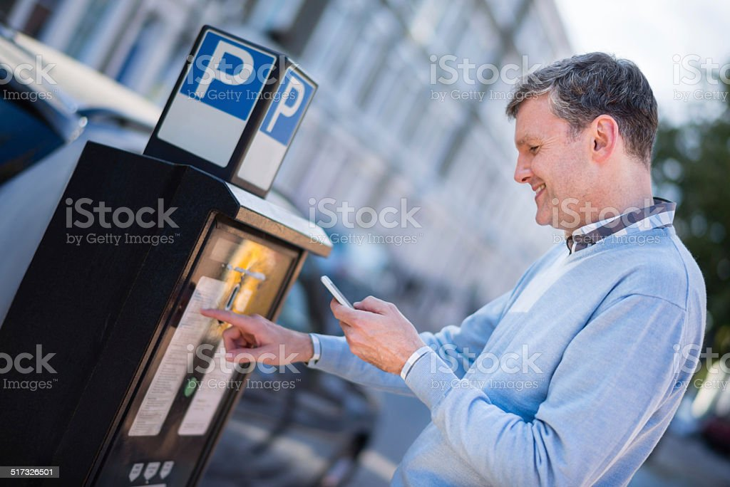 Man paying for parking stock photo