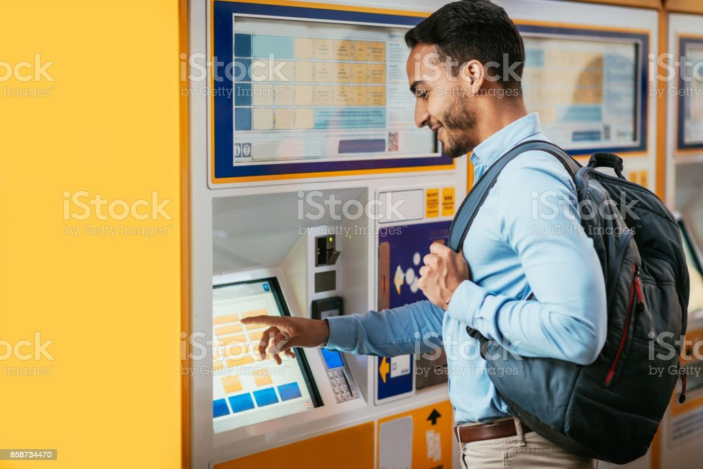 Man paying ticket on the touch display machine stock photo