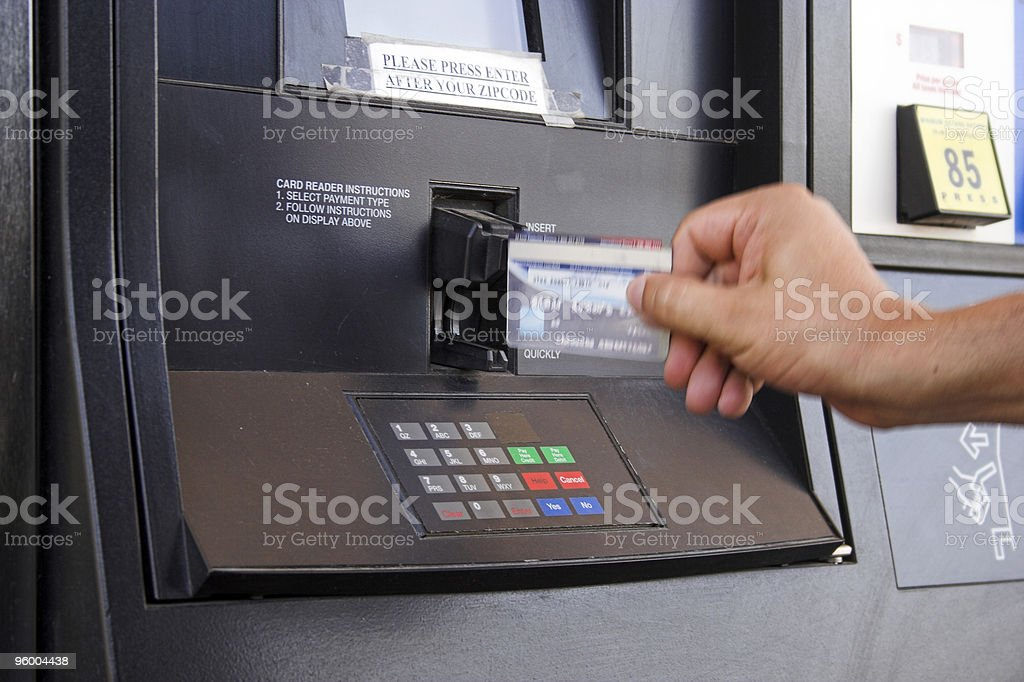 Man Paying with Credit Card at the Gas Pump royalty-free stock photo