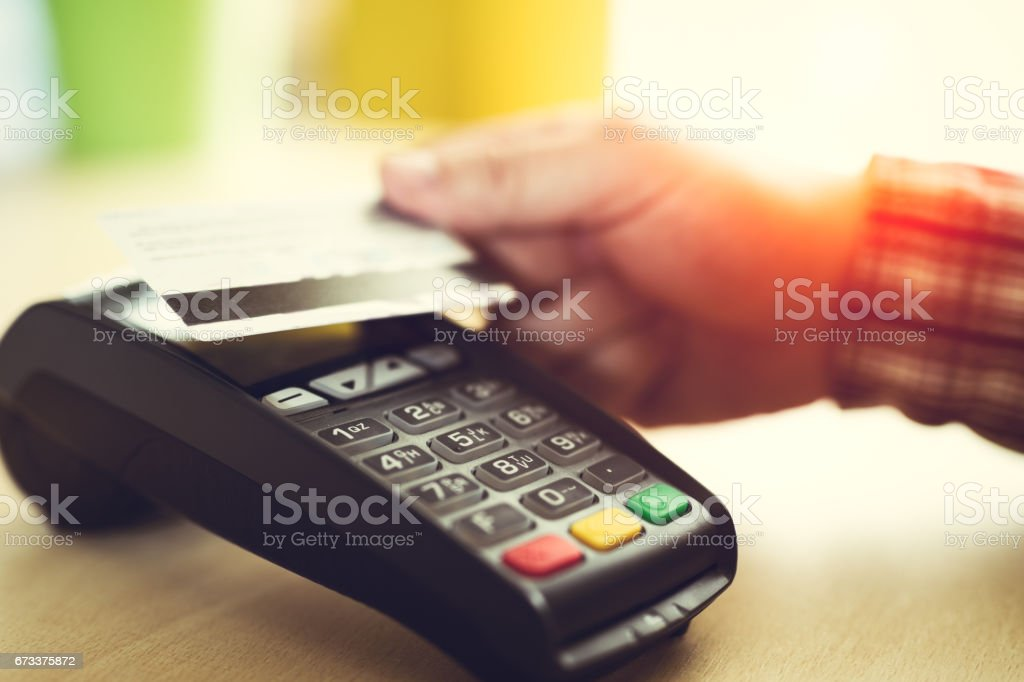 Man paying with NFC technology on credit card stock photo