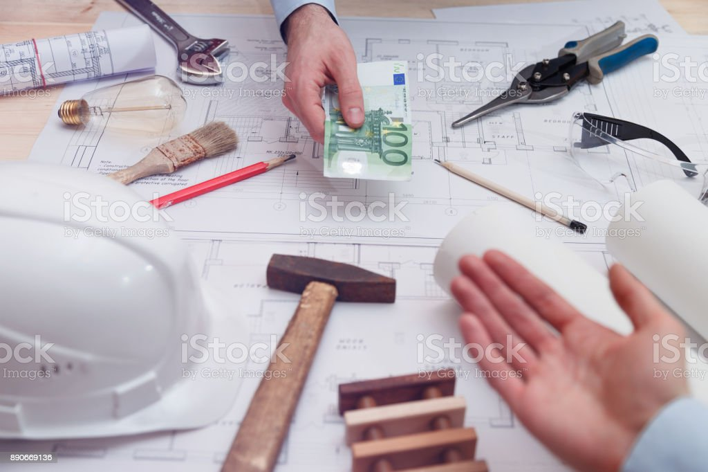 Man pays for engineering, construction and installation services stock photo