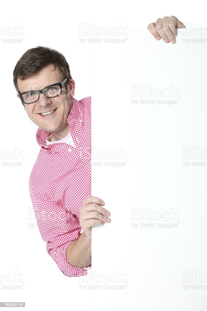 Man peeking from behind a placard royalty-free stock photo