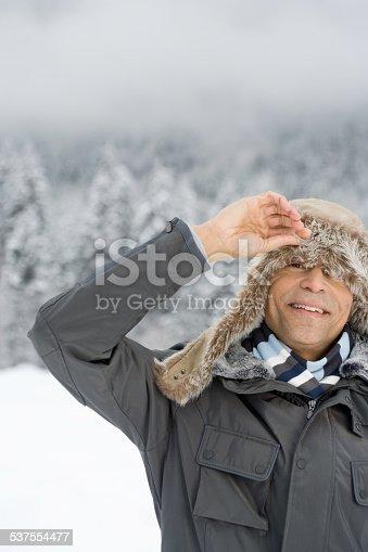 A man peeking through a deerstalker hat