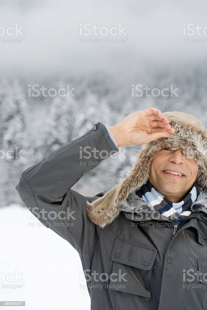 Man peeking through a deerstalker hat stock photo
