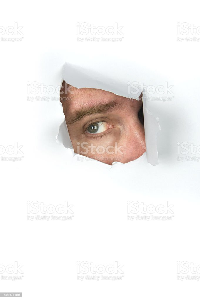 Man peeking through paper royalty-free stock photo