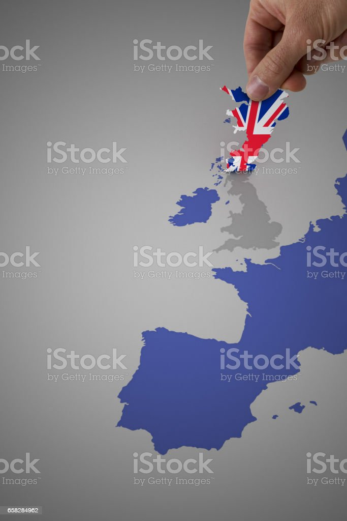 Map Of England And Europe.A Man Peeling Off England From A Europe Map Stock Photo Download