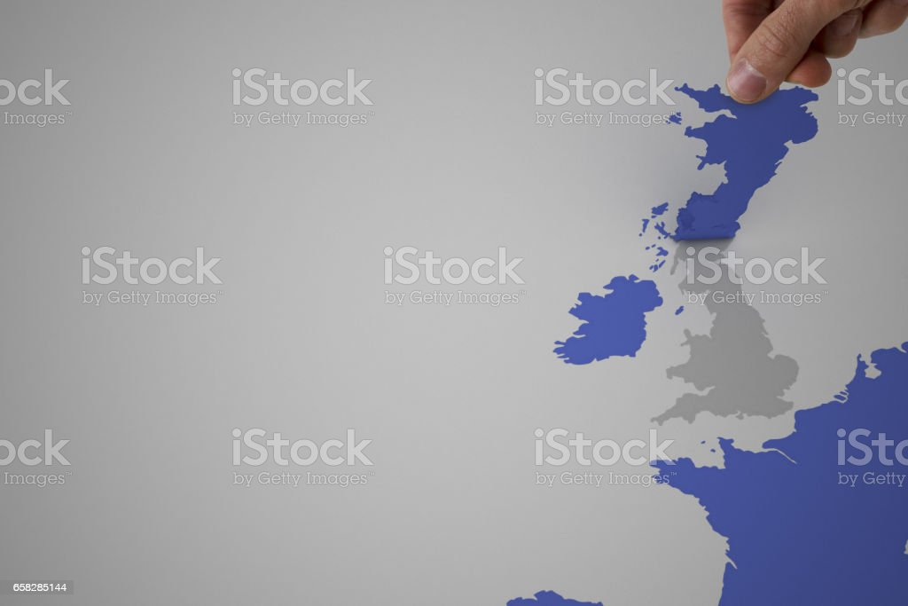 A Man Peeling Off England From A Europe Map Stock Photo More