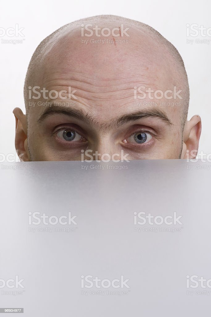 Man peering over a cubicle royalty-free stock photo