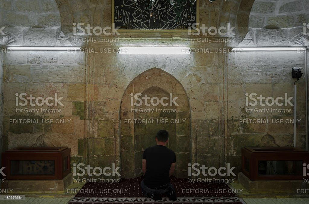 Man perform prayer (salah) stock photo