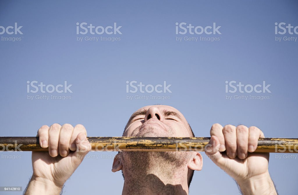 Man performing a chin up exercise royalty-free stock photo