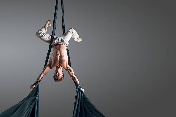Man performing aerial silk dance stock photo