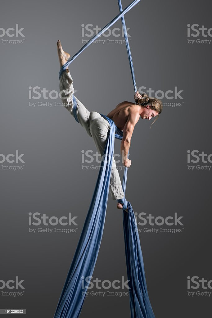Man performing aerial silk dance stock photo