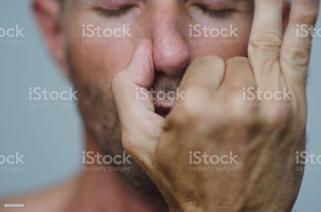 Man Performing Alternate Nostril Breathing stock photo