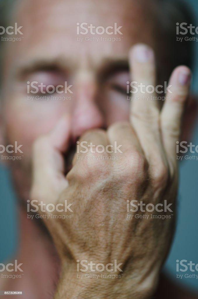 Man Performing Alternate Nostril Breathing stock photo