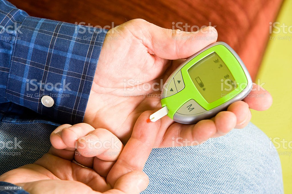 Man Performs Glucose Blood Test royalty-free stock photo