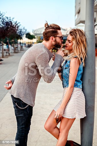 istock Man persuading a girl to kiss 679579086