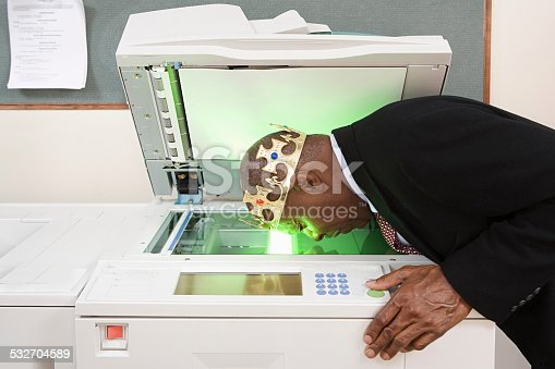 istock Man photocopying face 532704589