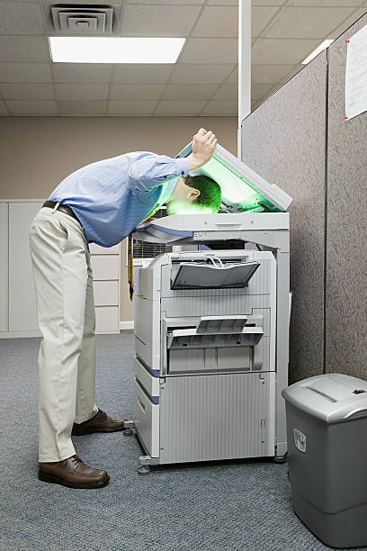 Man photocopying his head stock photo