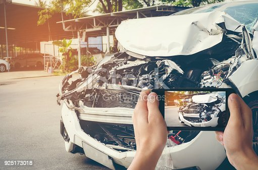 istock A man photographed his vehicle with accidental damage with a smart phone.Car Insurance Concept 925173018