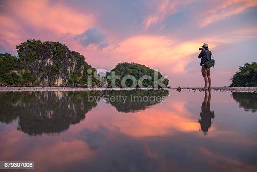 istock man photographer and summer landscape of Krabi, Thailand 679307008