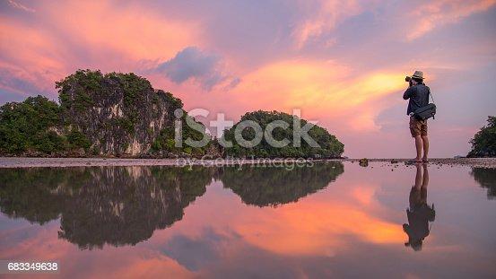 istock man photographer and summer landscape of Krabi, Thailand 683349638