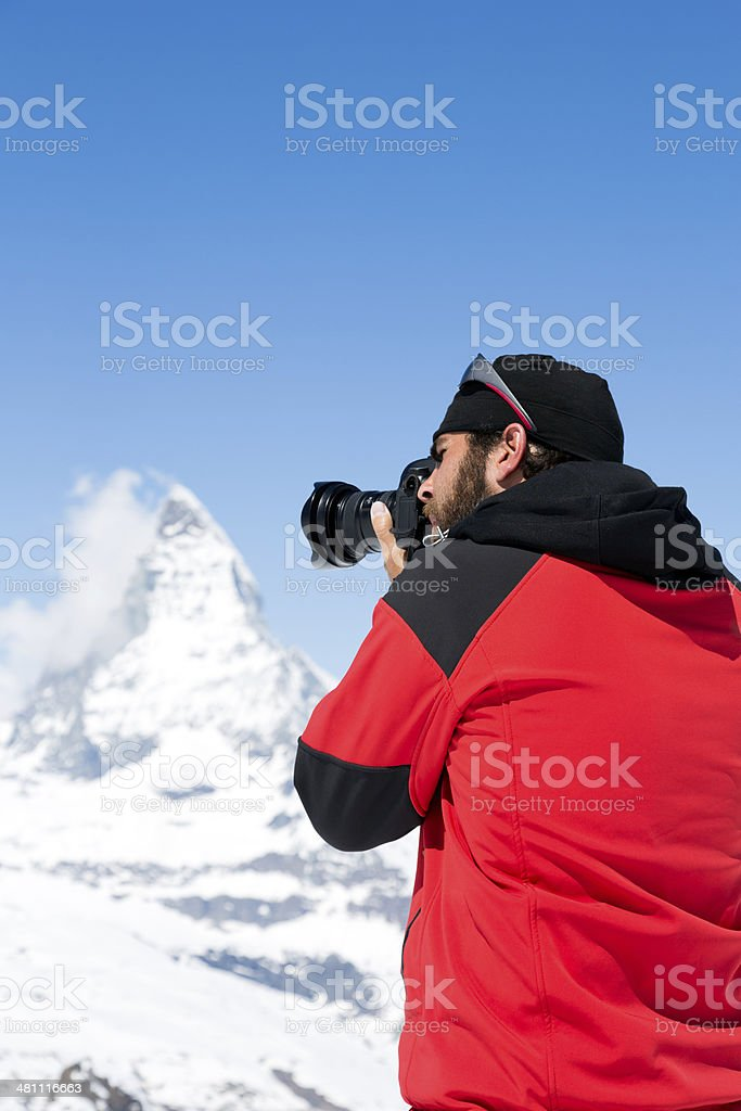 Man Photographer shooting at Matterhorn, Switzerland. royalty-free stock photo
