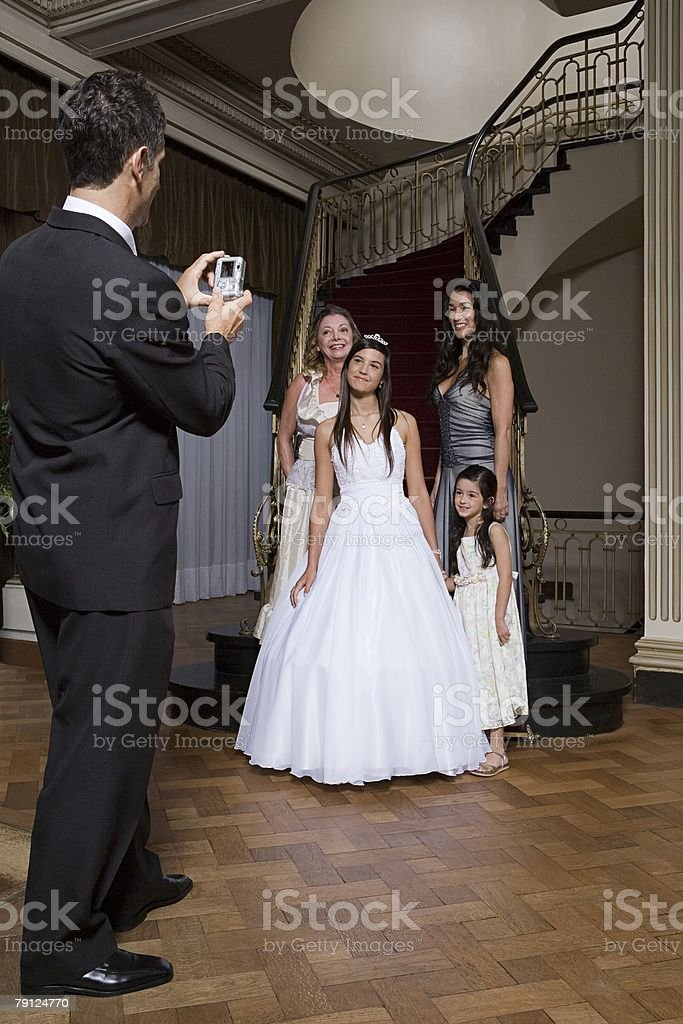 Man photographing quinceanera and family 免版稅 stock photo
