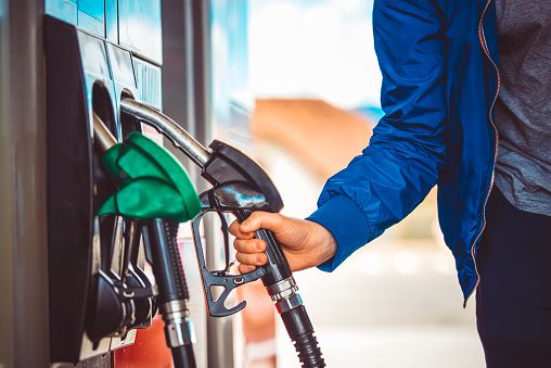 Male hand holding fuel pump nozzle, Diesel Fuel, Car,