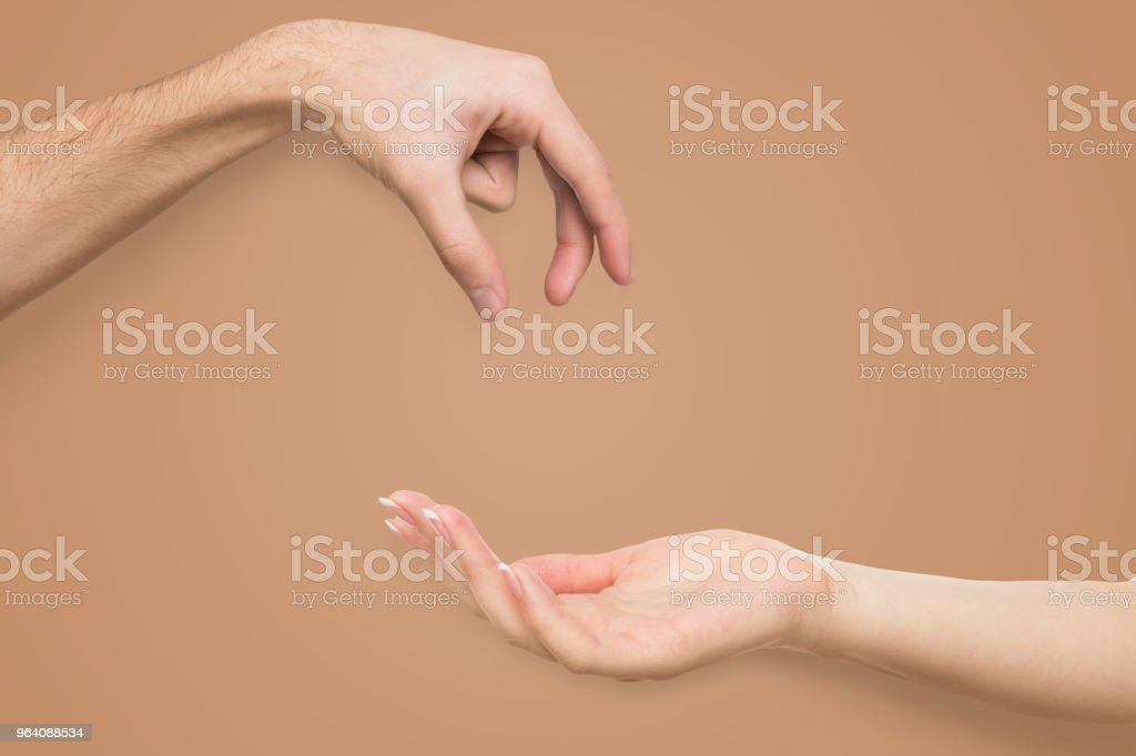 Man picking up or giving something to woman - Royalty-free Adult Stock Photo