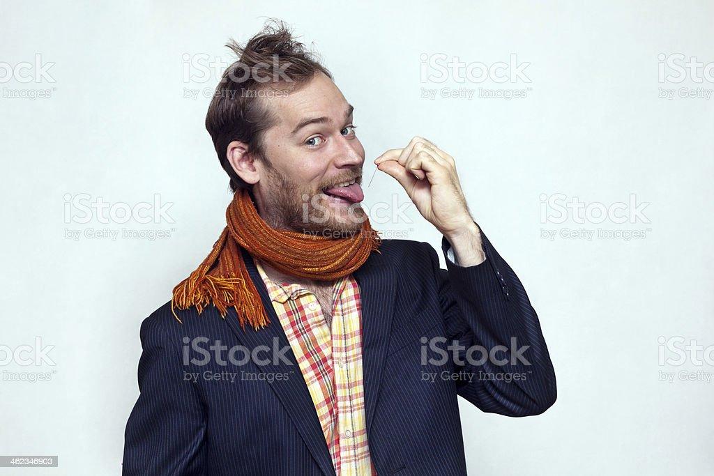 Man Piercing His Tongue With Pin stock photo