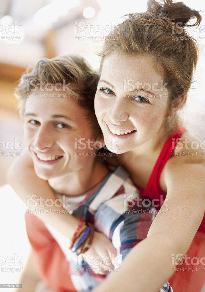 Man piggybacking woman royalty-free stock photo