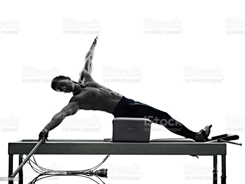 man pilates reformer exercises fitness isolated stock photo