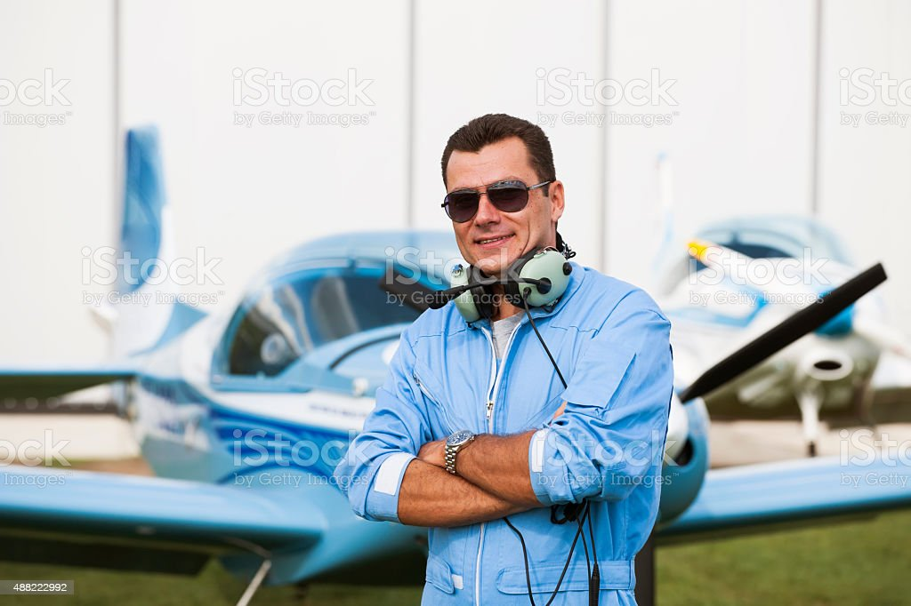 Man pilot looking at map, preparing for flying stock photo