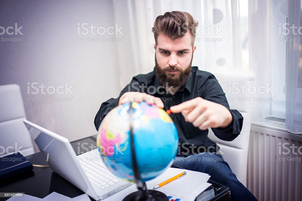 Man pinning destination stock photo