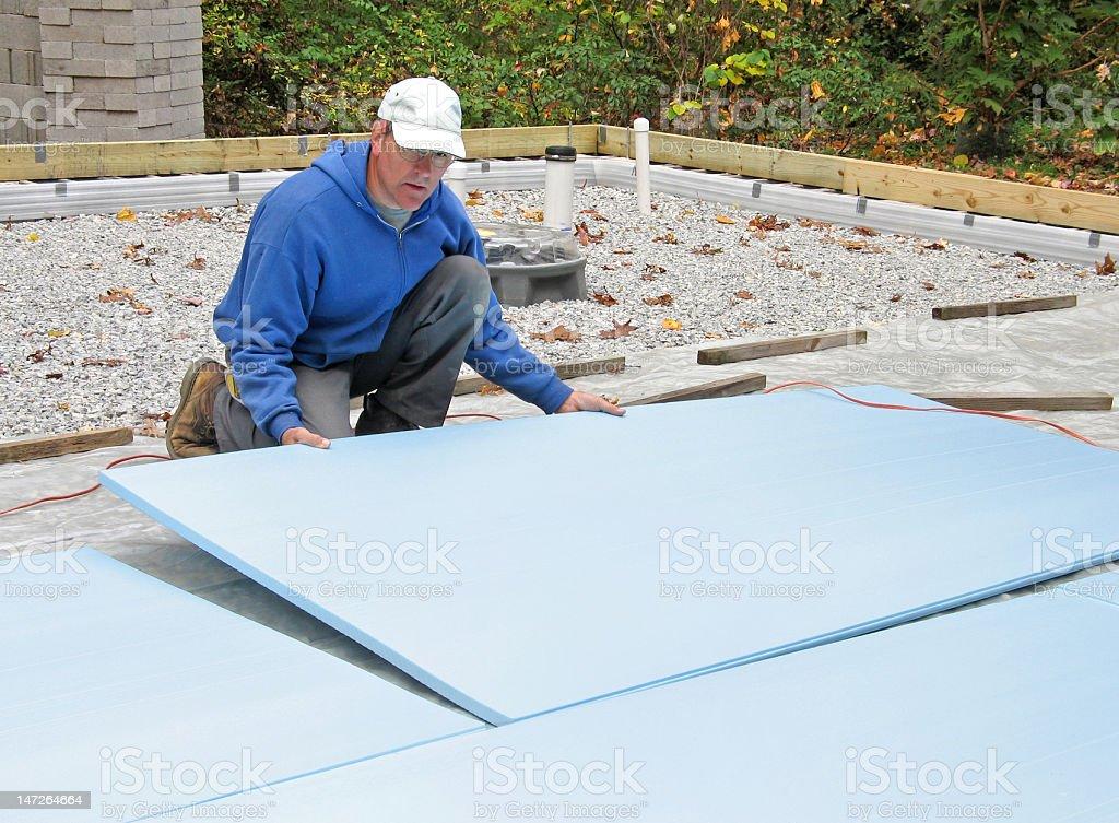 Man placing foam insulation stock photo