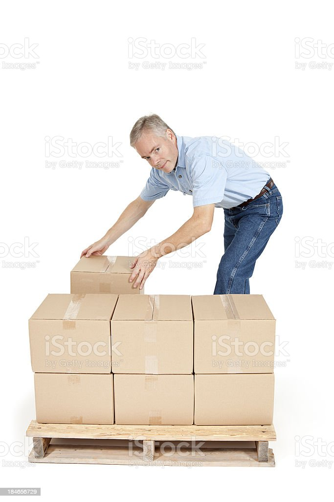 Man Placing Merchandise on a Shipping Pallet royalty-free stock photo