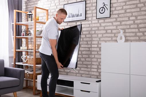 Man Placing New Television