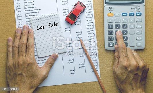 istock Man Planning Car fule expenses 631183096