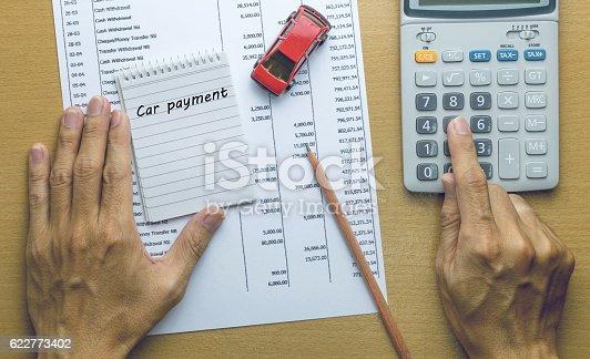 istock Man Planning Car payment 622773402