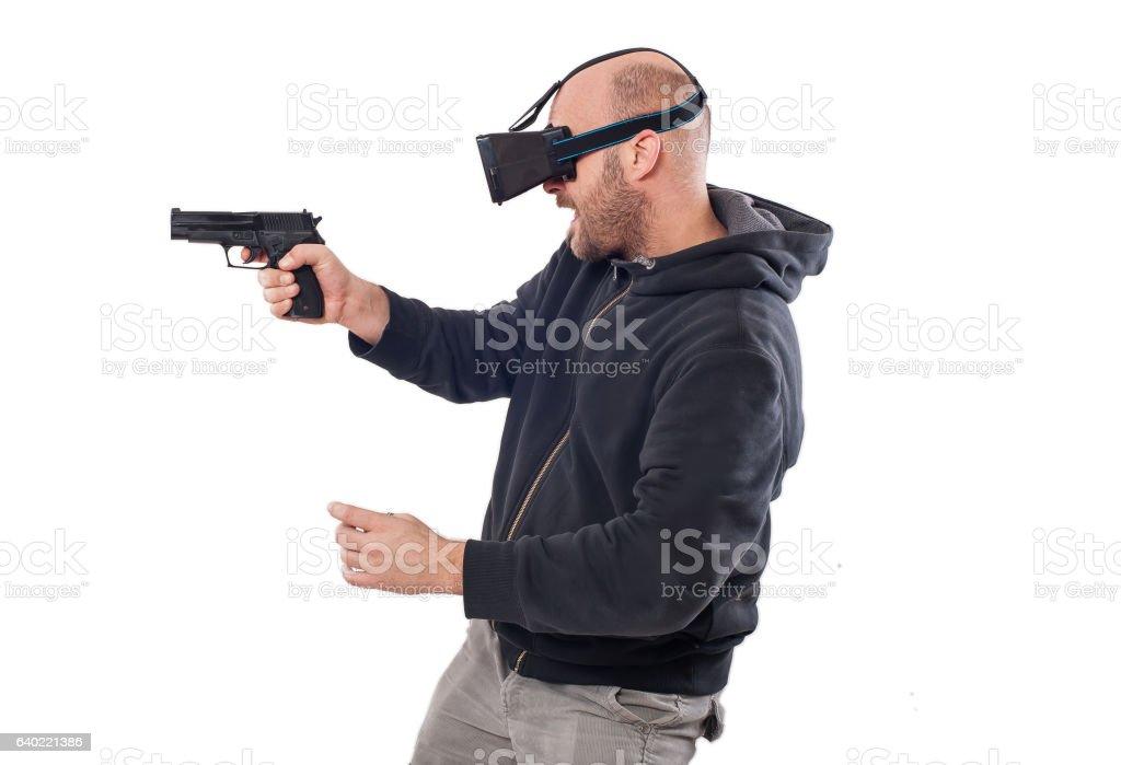 Man Play Vr Shooter Game With Virtual Reality Gun Glasses