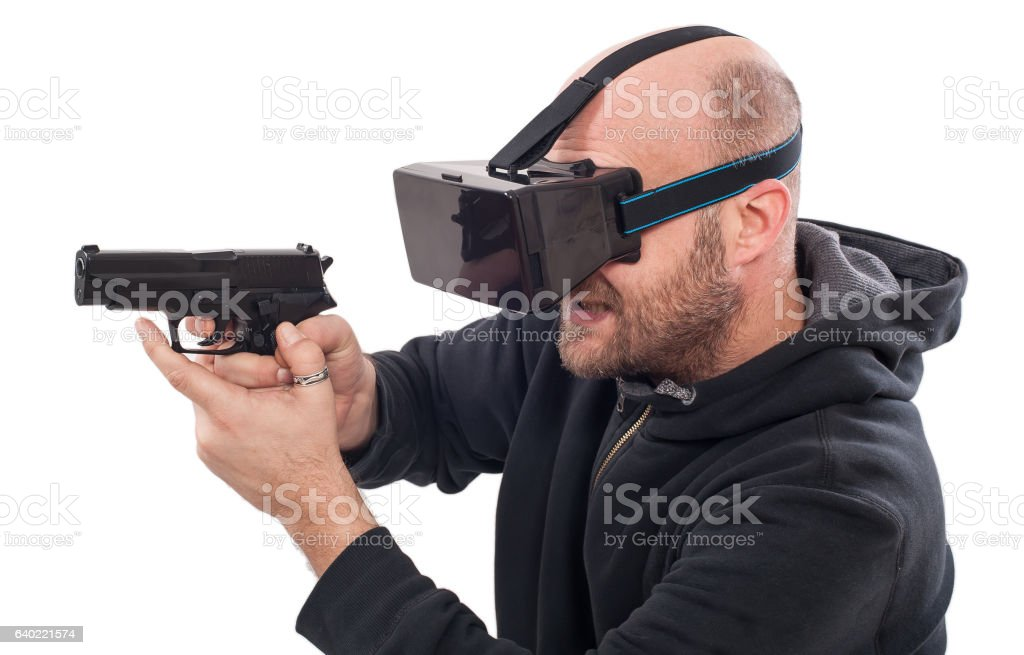 Man play VR shooter game with virtual reality gun glasses stock photo