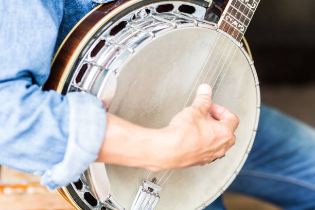 Man playing a banjo. Closeup shot of a man's hand strumming on a banjo. folk music stock pictures, royalty-free photos & images