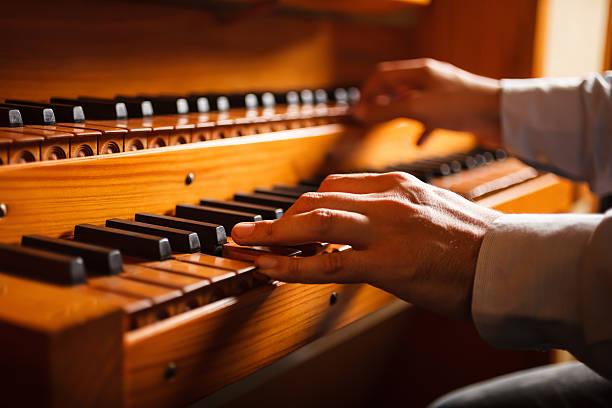 Man playing a church organ stock photo