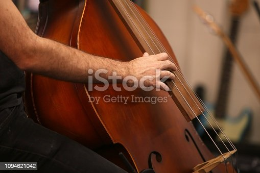 istock A man playing a double bass musical instrument during a live performance 1094621042