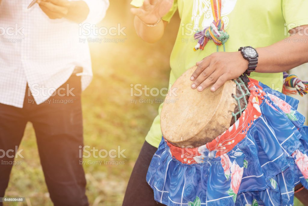 A man playing a Tomtom of thailand in selective focus. stock photo