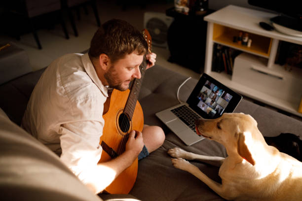 Man playing acoustic guitar on a video call picture id1226867866?b=1&k=6&m=1226867866&s=612x612&w=0&h=li7ngg23pv6z5 ugwhyi 29emraopvamf6azpb y9yc=