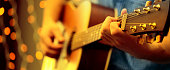 istock Man playing an acoustic guitar during a concert 1203778075