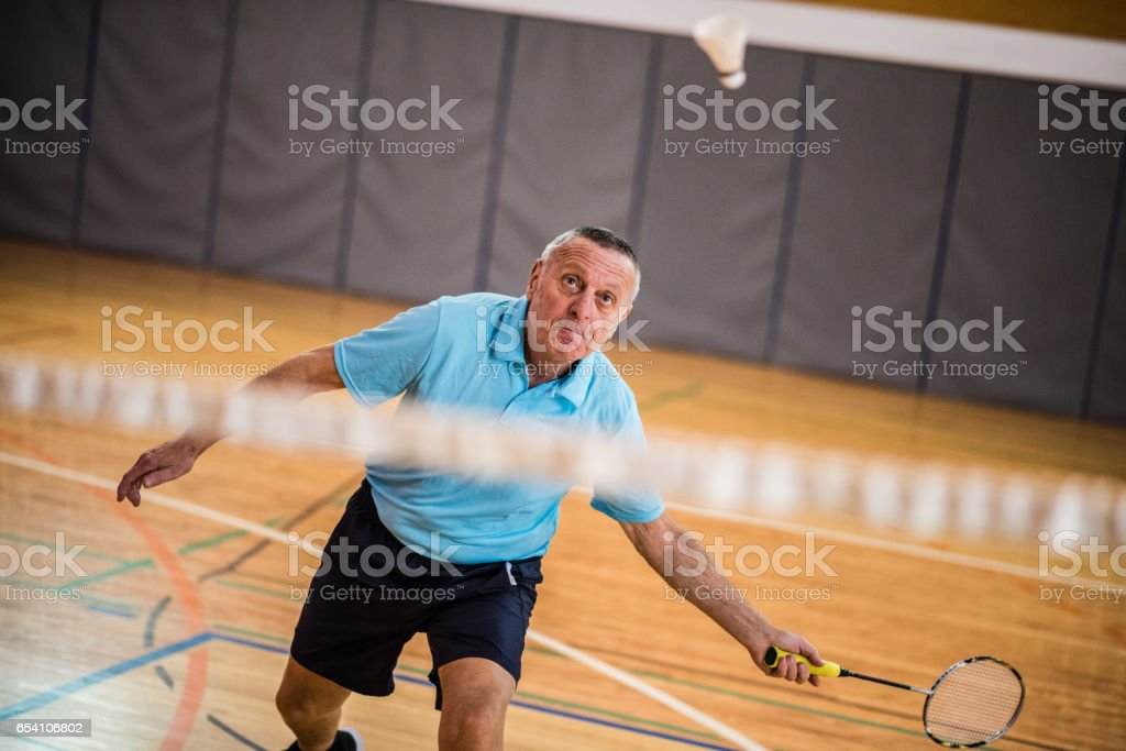 Man playing badminton stock photo