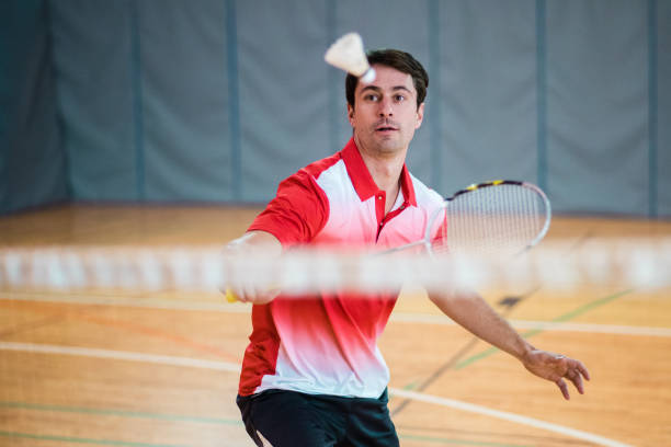 man playing badminton - badminton stock pictures, royalty-free photos & images