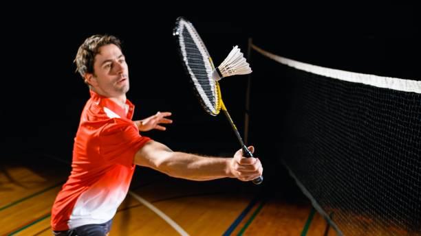 Man playing badminton stock photo
